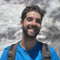 Image of Ben in front of mountains